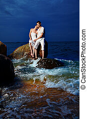 romantic couple at beach - outdoor portrait of young...