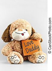 Love daddy message and toy on white