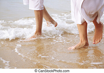 couple at beach - body part outdoor portrait of couple's...