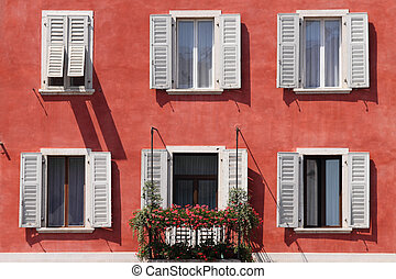 red facade with white windows