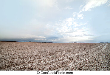 Little snow on field, - Little snow on plowed field in...