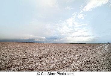 Little snow on field, - Little snow on plowed field in...