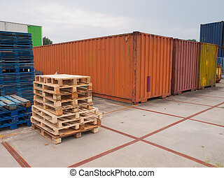 containers and pallets waiting on a trading site