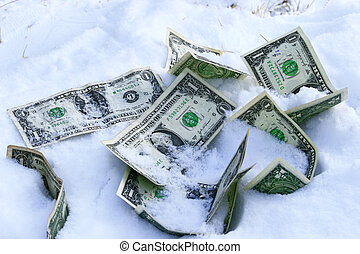 Frozen accounts - Dollar bills on the snow concept for...