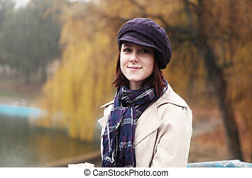Beautiful girl at outdoor in autumn time.