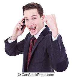 winner on the phone - happy business man with cellular phone...