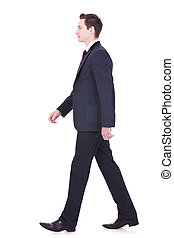 business man walking forward - picture of a young business...