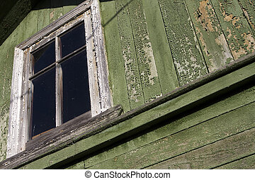 old wooden window - a fragment of an old green house with...