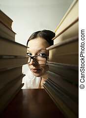 girl peeking from the books