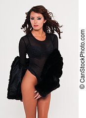 Leotard - Beautiful young brunette in a leotard and fur coat