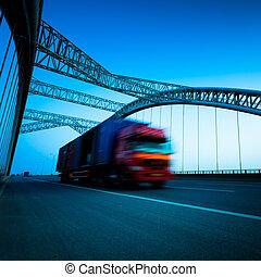 truck motion blur - speeding truck go through the bridge