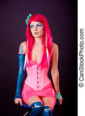 Young woman dressed in bright latex clothes