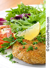 Schnitzel and Salad - Schnitzel with salad, garnished with...