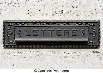 Italian iron mailbox - An iron vintage mailbox on gray wall,...