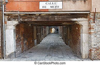 Calle de Mezo- a typic small street passage in Venice,Italy