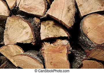 wood logs - a background of the wooden brown logs texture