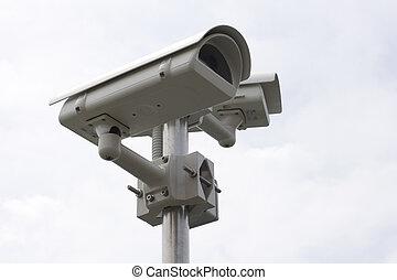 Surveillance Camera on a sky background