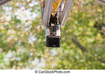 Surveillance camera on leaves background