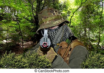Soldier in camouflage airsoft sport