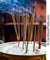 Burning incense sticks in chinese temple