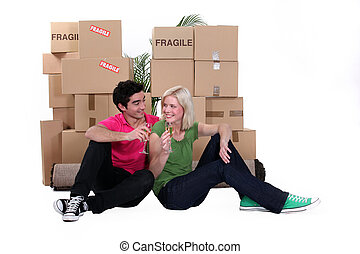 Young couple moving in with champagne
