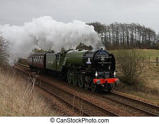 UK Steam Engine - Steam Engine Tornado passing Cluny, SCO UK...