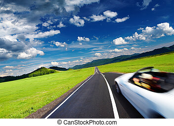 Sports car in motion blur on empty road