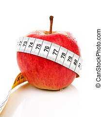 healthy diet; red apple with measure tape