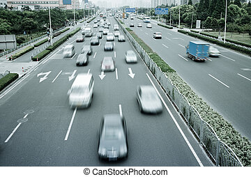 traffic of city - group of cars on the street road at...
