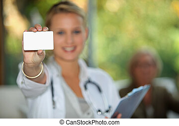 Doctor showing business card