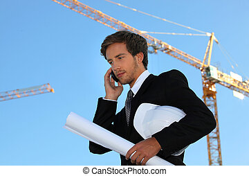 Young and handsome engineer working on-site