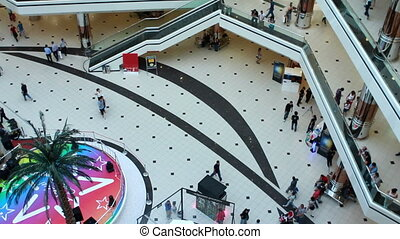 "people walking in a shopping center - ""people walking in a..."
