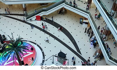 people walking in a shopping center - people walking in a...