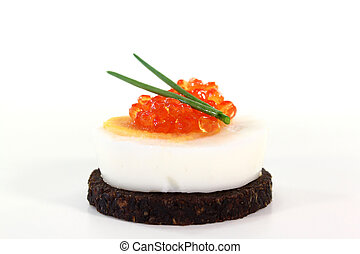 Hors d oeuvre - Pumpernickel bread with boiled egg, caviar...