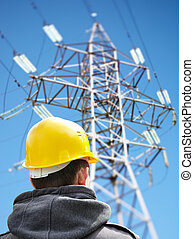 worker against power lines - utility worker against power...