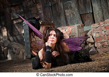 Daydreaming Fairy - Serious barefoot fairy in suitcase in a...