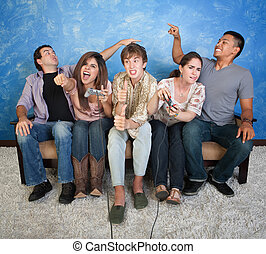 Friends Playing Video Game - Five excited friends on couch...