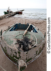 an old fishing boat at the beach