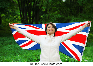 Flag of Great Britain - Young woman holding flag of Great...