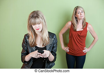 Teen Texting - Concerned mom watches teen send text messages...