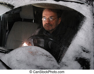 man driving car in the winter