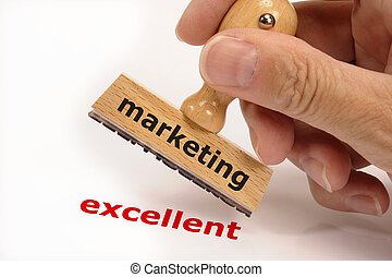 rubber stamp marked with marketing in hand and its copy...