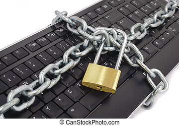 locked chain on computer keyboard as sybol for danger in...