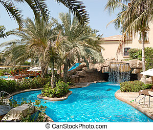 Swimming pool at luxury hotel, Dubai, UAE - Swimming pool at...