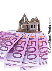 euro banknotes and shell of a house - many euro banknotes...