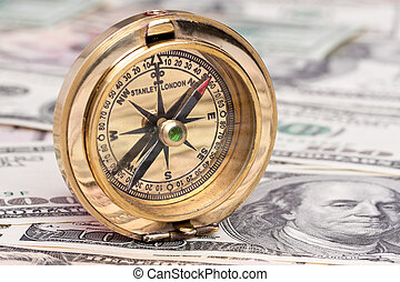 dollar currency notes and compass - many dollar bills and a...