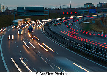 motorway at night - the lights of passing cars on a highway...