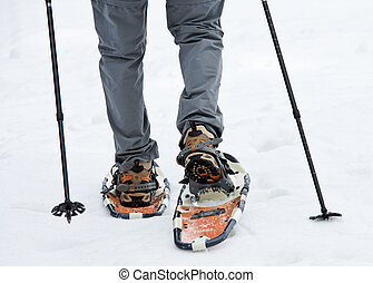 senior when snowshoeing in winter - an elderly man in winter...