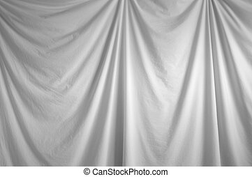 white draped backdrop - a white fabric draped backdrop...