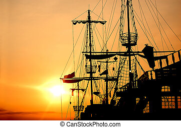 Pirate ship in sunset scenery